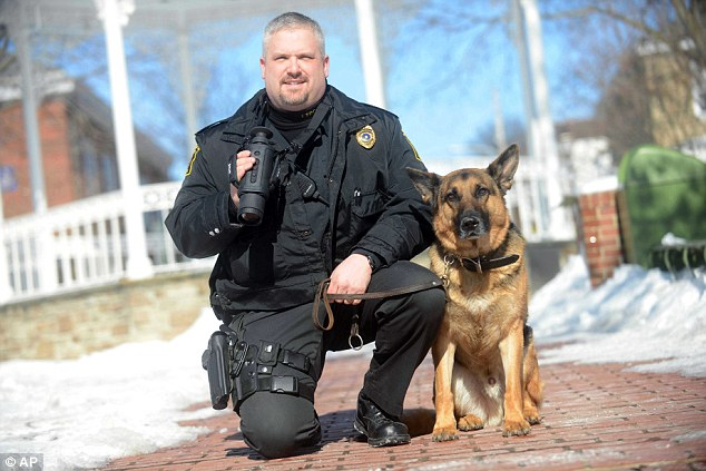 Partners to the end: Ligonier, Pennsylvania Township Police Officer Eric Eslary died Tuesday morning in a head-on crash. His K-9 partner Belk refused to leave his side. The two pictured above in a photo from February