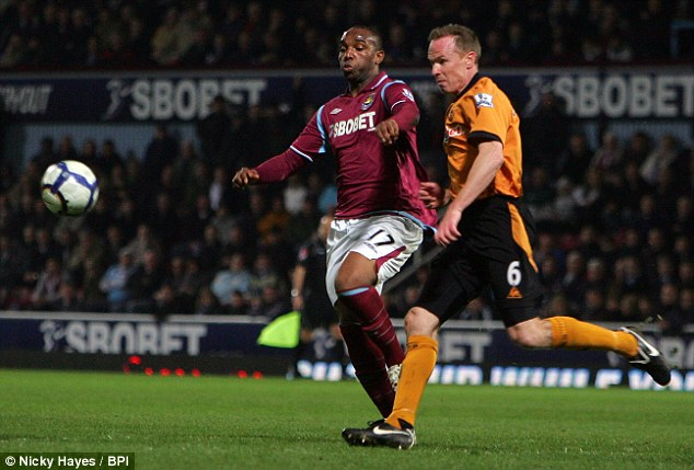 Benni McCarthy, pictured left, playing for West Ham United and Jody Craddock of Wolverhampton, right