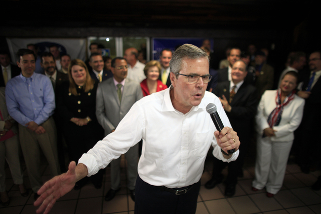In this photo taken April 28, 2015, Jeb Bush speaks during a town hall meeting with Puerto Rico's Republican Party in Bayamon, Puerto Rico. Hillary Rodham Cl...