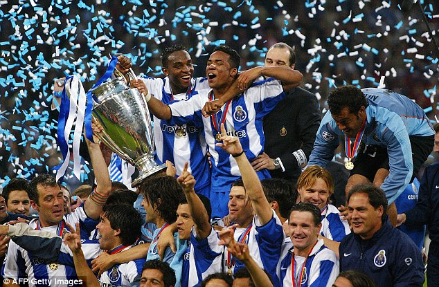 FC Porto's Benni McCarthy, top left, holds the trophy as he celebrates with teammates from FC Porto after beating Monaco 3-0 in the Champions League final in 2004