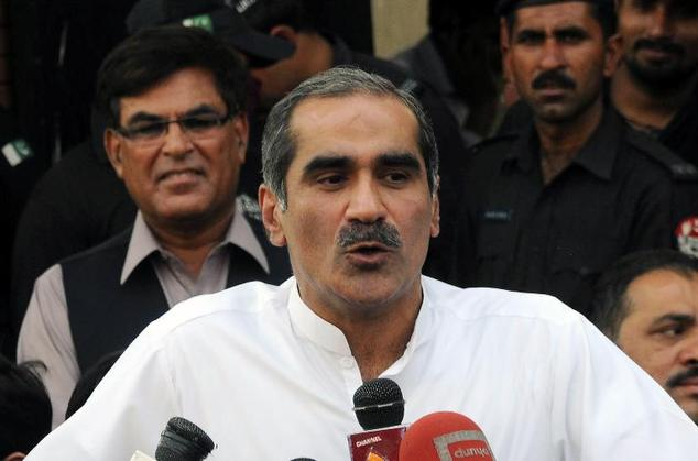 Pakistan's Minister for Railways Khawaja Saad Rafique talks to the media outside a court in Lahore on May 4, 2015