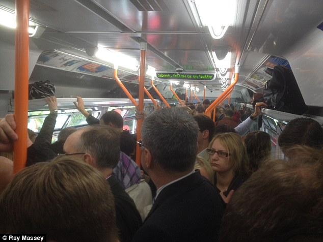 'Sardine-like conditions': The signalling fiasco meant seven platforms at Waterloo were out of action, causing gridlock further back on the tracks as stranded trains queued up to get in