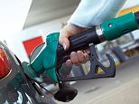 A woman filling her car at a petrol station. M otors alamy AXT852.jpg