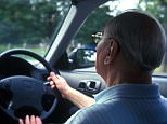 A back view of an elderly man driving. Drivers over 75 could face IQ tests.    AX7GC0