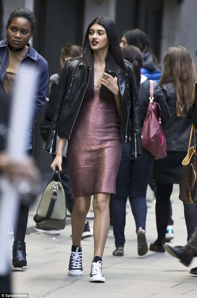Simple: Neelam was spotted earlier that day wearing the same outfit, as she held onto her mobile phone while walking the streets of London town