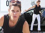 Retiring supermodel Cindy Crawford steps out with no makeup not quite looking like herself as she runs errands just ten days ahead of her 50th birthday in Beverly Hills, CA. Wednesday, February 10, 2016.  X17online.com
