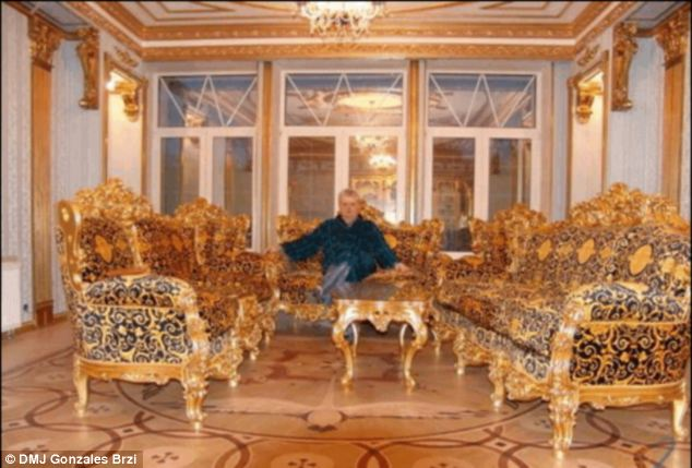 Midas touch: after gold plated tables and toilets Brzi continues his love for the precious metal on this sofa set