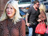Los Angeles, CA - Tori Spelling heads to a meeting dressed in throwback look. She is wearing camel flares with platform heels and a polka dot blouse. To complete the 70s look, Tori carries a tassel cross body bag. The 42-year-old actress recently appeared on 'Kocktails with Khloe' where she revealed her alter-ego 'Terri.' Tori explains, ìWhen Terri comes to visit she is cray-cray and one of her things is she likes to pee and she pees anywhere. Sheíll piss under a table, everyone raise your legs, she will pee in a potted plant.î\nAKM-GSI          February 10, 2016\nTo License These Photos, Please Contact :\nSteve Ginsburg\n(310) 505-8447\n(323) 423-9397\nsteve@akmgsi.com\nsales@akmgsi.com\nor\nMaria Buda\n(917) 242-1505\nmbuda@akmgsi.com\nginsburgspalyinc@gmail.com