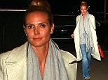 Heidi Klum goes casual for flight out of LA, rocking jeans and a long white jacket, with her hair pulled back, on Tuesday, February 9, 2016  X17online.com