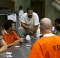 """This image released by A&E Networks shows a scene from """"60 Days In,"""" a 12-episode series about a group of innocent civilians who spent two months in an Indiana jail. The series premieres with a double episode on March 10 on A&E. (A&E Networks via AP)"""