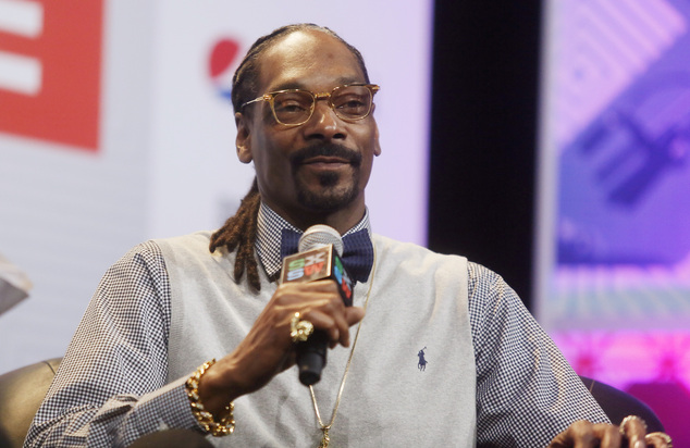 """FILE - In this March 20, 2015 file photo, rapper Snoop Dogg takes part in the """"Keynote Conversation with Snoop Dogg"""" at the South by Southwest festival in Au..."""