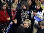 In this Feb. 9, 2016, photo, Democratic presidential candidate Hillary Clinton mingles with supporters at her New Hampshire presidential primary campaign rally in Hooksett, N.H. For young women, political revolution is currently trumping the idea of a Madame President. In New Hampshire, women under the age of 45 overwhelmingly backed Bernie Sanders over Clinton, exit polls showed. (AP Photo/Elise Amendola)