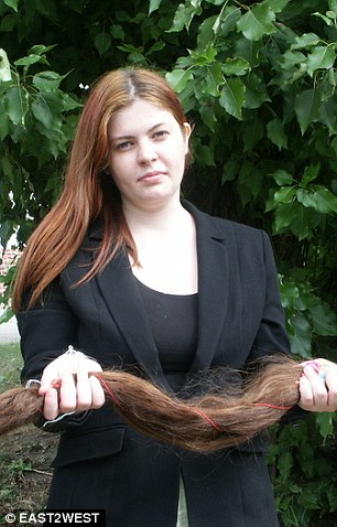 An anonymous Russian redhead holds locks lopped off. While Russian women make next to nothing for selling their hair, women in Britain and the USA pay hundreds of pounds to have extension woven into their hair