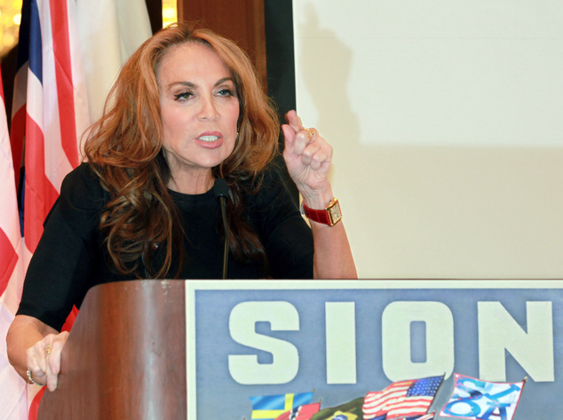 In this Sept. 11, 2012 photo, blogger and activist Pamela Geller speaks at a conference she organized entitled ¿Stop Islamization of America,¿ in New York. T...