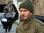 David Beckham pictured with his hands full after the school run as he took his daughter's scooter indoors for her.\nNoble Draper Pictures.\n**BYLINE: NOBLE/DRAPER**