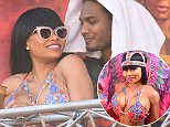 EXCLUSIVE: **MINIMUM FEES APPLY**STRICTLY NO WEB UNTIL 11PM ET FEB 10th 2016** Look away now Rob! Blac Chyna is spotted partying with a mystery man in Trinidad as she wears an extremely revealing Carnival outfit. The hunky man cosied up to the hip hop model, who has been dating troubled Rob Kardashian, as she danced on the stage of an event at the world famous party. Chyna, who is wearing what is rumoured to be an engagement ring from Rob, certainly didn't seem to mind and smiled as he got up close and even put his arm around her. Kardashian has kept a low public profile while battling weight problems in recent months and may well not want to see these pictures. Blac Chyna is in the country with fellow model Amber Rose for the Trinidad Carnival.   Pictured: Blac Chyna Ref: SPL1223438  100216   EXCLUSIVE Picture by: 246PAPS/Splash News  Splash News and Pictures Los Angeles: 310-821-2666 New York: 212-619-2666 London: 870-934-2666 pho