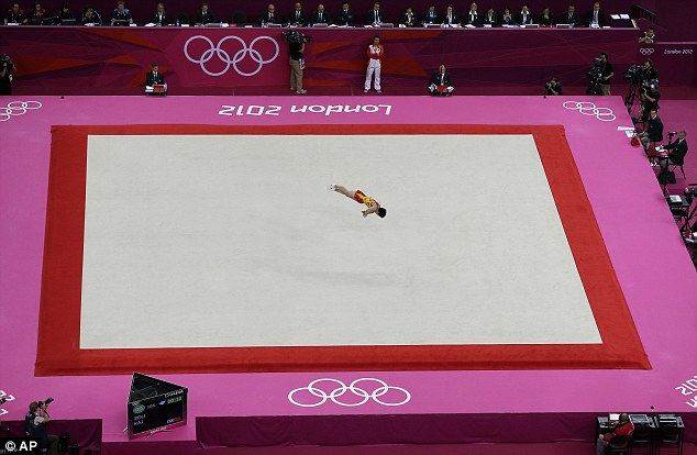 Centre stage: Chinese gymnast Zou Kai put in a wonderful performance to take the gold