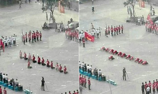 Shenyang restaurant staff spotted kneeling down and bowing to bosses