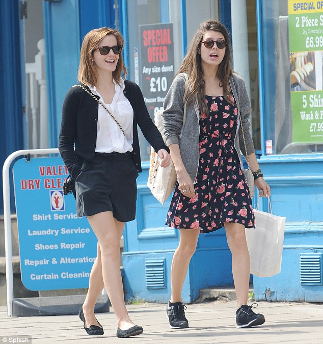 Emma Watson makes the most out of the sunshine in London on Saturday as she goes bare-legged