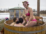 Participants bathe during a European Sauna marathon in Estonian Winter Capita in Otepaa, Estonia, Saturday, Feb. 6, 2016. Participants need to visit as many saunas as possible in the shortest amount of time, as well as dip in ice holes and participate in various challenges along the way.  (AP Photo/Vitnija Saldava)