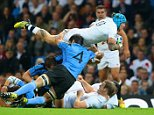MANCHESTER, ENGLAND - OCTOBER 10:  Jack Nowell of England is tackled by Santiago Vilaseca of Uruguay during the 2015 Rugby World Cup Pool A match between England and Uruguay at Manchester City Stadium on October 10, 2015 in Manchester, United Kingdom.  (Photo by David Rogers/Getty Images)