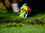 Close up of the boots of the Tonga players boots as it turns up the turf as they practice a scrum during warm up at the Rugby World Cup 2015 match between New Zealand and Tonga played at St. James' Park, Newcastle, on October 9th 2015