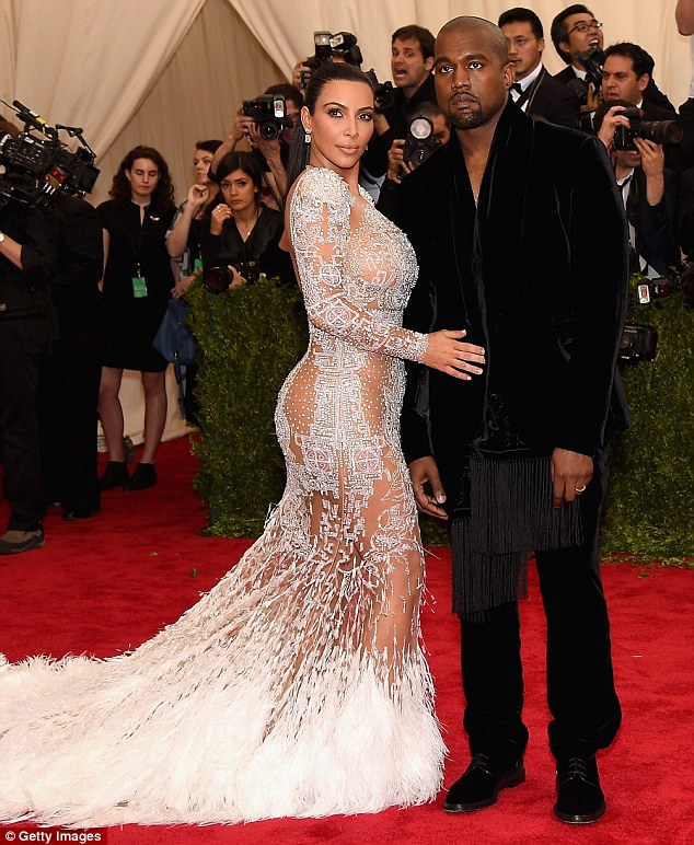 Bringing the glamour: Kanye West, pictured with wife Kim Kardashian at the Met Gala in New York City on Monday night, will headline Glastonbury's Saturday night slot