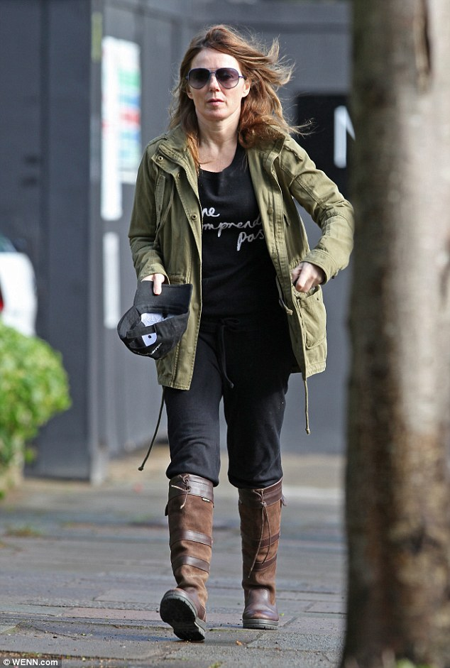 She's back! Geri Halliwell enjoyed an early morning stroll in London on Wednesday following her recent trip to Marrakech to celebrate David Beckham's 40th birthday