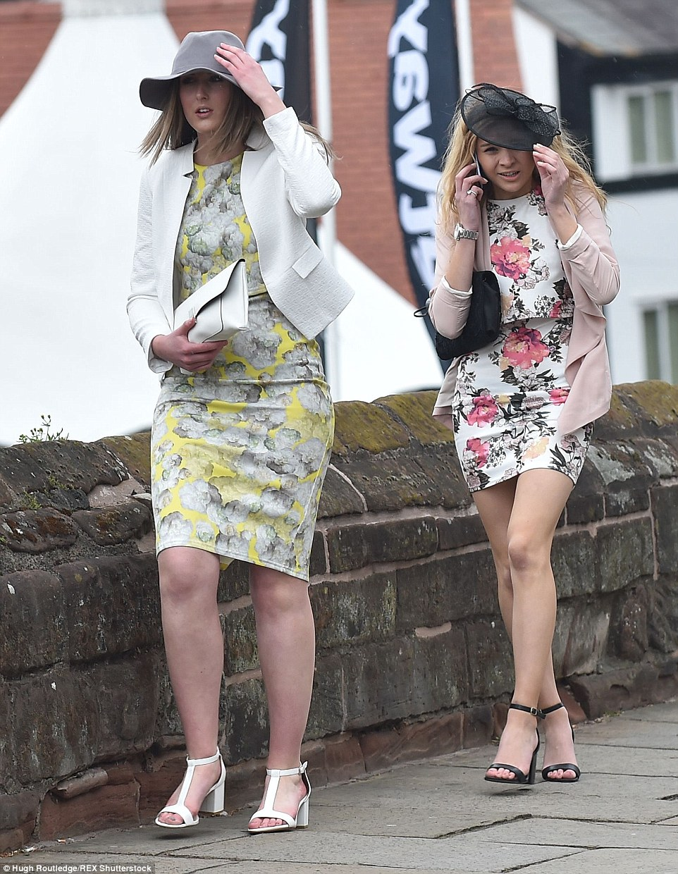 These ladies were holding their hats down before they had even entered the racecourse area