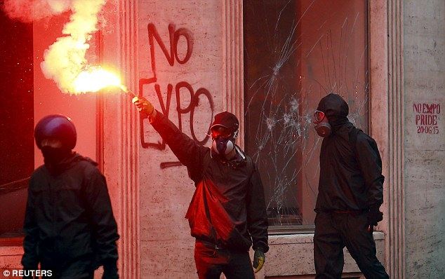Luxury watchmaker Rolex demanded an apology from Italy's prime minister today for saying that violent demonstrators who devastated Milan against the city's Expo global fair were 'rich, spoiled brats with Rolexes'