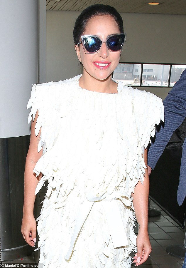 Relatively simple: Later on Tuesday, Gaga wore a feathery white outfit to arrive at Los Angeles International Airport after leaving the capital and hosting an afterparty