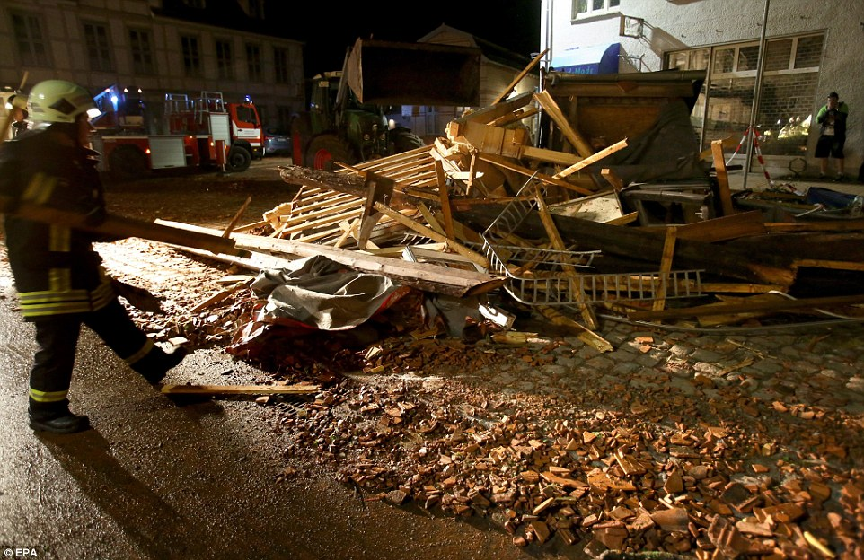 Pieces of broken wood from wrecked roofs are being piled up in the main square along with a mountain of debris from the storm
