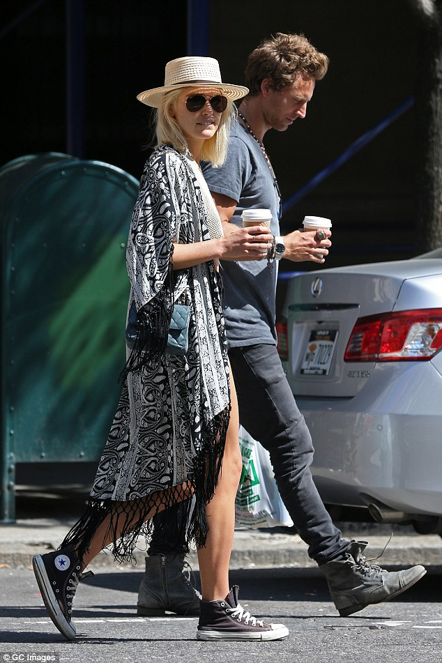 Caffeine fix!Ashley was out-and-about in the Big Apple with her fiancé Buck Palmer and the pair of them stopped off at a coffee shop to pick up a hot beverage