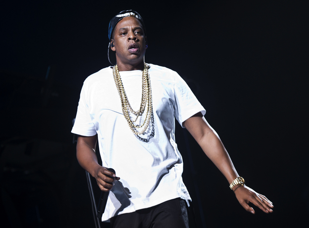FILE - In this Oct. 10, 2013 file photo, U.S singer Jay-Z performs on stage at the O2 arena in London, as part of his Magna Carta World Tour.  (Photo by Joel...