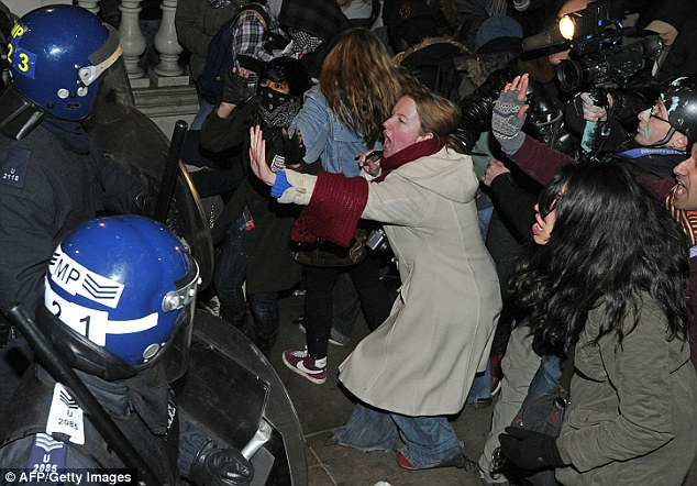Anarchy: Protesters confront riot police during Thursday night's clashes