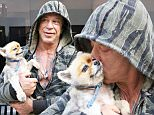 Mickey Rourke out with his pet dog in Beverly Hills \n\nPictured: Mickey Rourke\nRef: SPL1229572  160216  \nPicture by: KAT / Splash News\n\nSplash News and Pictures\nLos Angeles: 310-821-2666\nNew York: 212-619-2666\nLondon: 870-934-2666\nphotodesk@splashnews.com\n