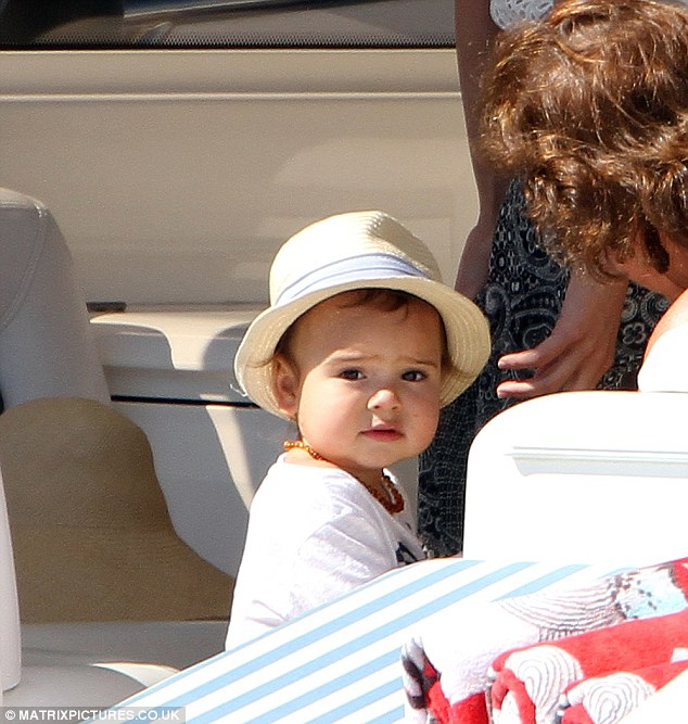 The cutest: Baby Flyyn looked adorable in his small fedora which he teamed with a white top and blue shorts
