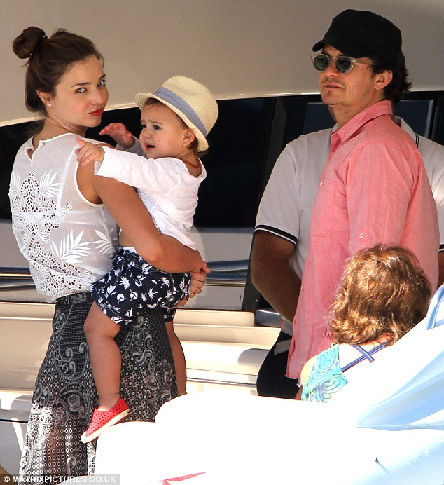 Boating brigade: Miranda Kerr and Orlando Bloom enjoyed a day out at sea with baby Flynn yesterday off Hamilton Island, Australia