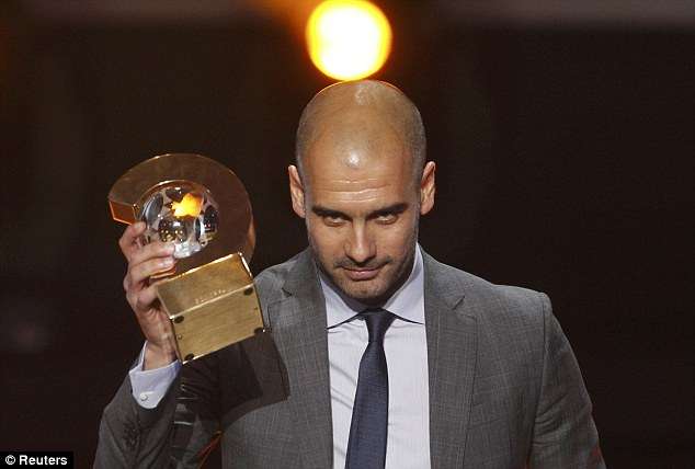 Top man: Barcelona's Pep Guardiola wins the FIFA World Coach of the Year award