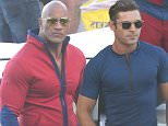 FIRST ON SET PHOTOS: Zac Efron and The Rock seen on the first day of filming the 'Baywatch' movie in Boca Raton FL. The bulked up actors appeared to share a laugh as Zac had his hair and make-up touched up, before hopping on a boat to film. Boca Raton, Florida - Monday February 22, 2016. Photograph: Thibault Monnier, © Pacific Coast News. Los Angeles Office: +1 310.822.0419 sales@pacificcoastnews.com FEE MUST BE AGREED PRIOR TO USAGE