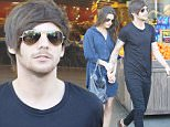 Louis Tomlinson and his girlfriend Danielle Campbell are spotted doing some grocery shopping at Bristol Farms in Beverly Hills, amid rumors that One Direction planning to split up. Saturday, February 20, 2016. X17online.com