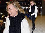 EXCLUSIVE: Margot Robbie arrives at JFK airport in NYC\n\nPictured: Margot Robbie\nRef: SPL1233001  210216   EXCLUSIVE\nPicture by: Splash News\n\nSplash News and Pictures\nLos Angeles: 310-821-2666\nNew York: 212-619-2666\nLondon: 870-934-2666\nphotodesk@splashnews.com\n