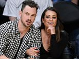 LOS ANGELES, CA - JANUARY 05:  Lea Michele (R) and Matthew Paetz attend a basketball game between the Golden State Warriors and the Los Angeles Lakers at Staples Center on January 5, 2016 in Los Angeles, California.  (Photo by Noel Vasquez/GC Images)