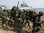 South Korean Marines march after they landed on the beach during the U.S.-South Korea joint landing military exercises as a part of the annual joint military exercise Foal Eagle between South Korea and the United States in Pohang, south of Seoul, South Korea, Monday, March 30, 2015. (AP Photo/Lee Jin-man)