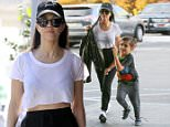 Calabasas, CA - 'KUWTK', Mason Disick, 6, is all grown-up and opening the door for his mom as they leave the dentist office.  Kourtney Kardashian seemed delighted at her young boy and was seen smiling at him as they made their way back to the car.  She was seen in a black baseball cap, white cropped tee, black high-waisted sweatpants, and white sneakers.\nAKM-GSI          January 11, 2016\nTo License These Photos, Please Contact :\nSteve Ginsburg\n(310) 505-8447\n(323) 423-9397\nsteve@akmgsi.com\nsales@akmgsi.com\nor\nMaria Buda\n(917) 242-1505\nmbuda@akmgsi.com\nginsburgspalyinc@gmail.com