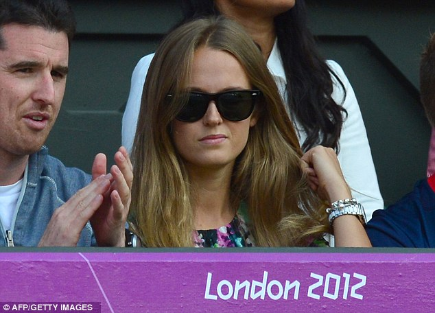 Number one fan: Kim Sears watched on as Murray clinched the Olympic title at Wimbledon
