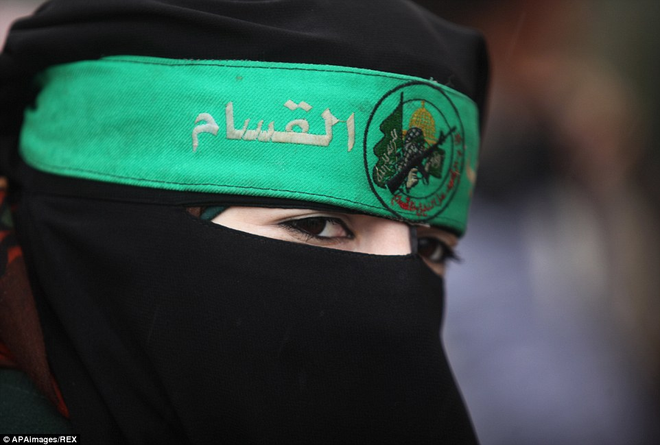 A Palestinian woman, in a niqab, attends the parade. Hamas is shunned by the West as a terrorist organisation