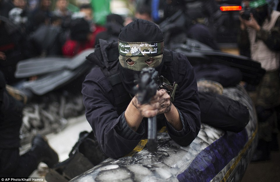 Hamas has neither confirmed nor denied such tests. Pictured, a masked gunman points his gun at the camera in this chilling photograph
