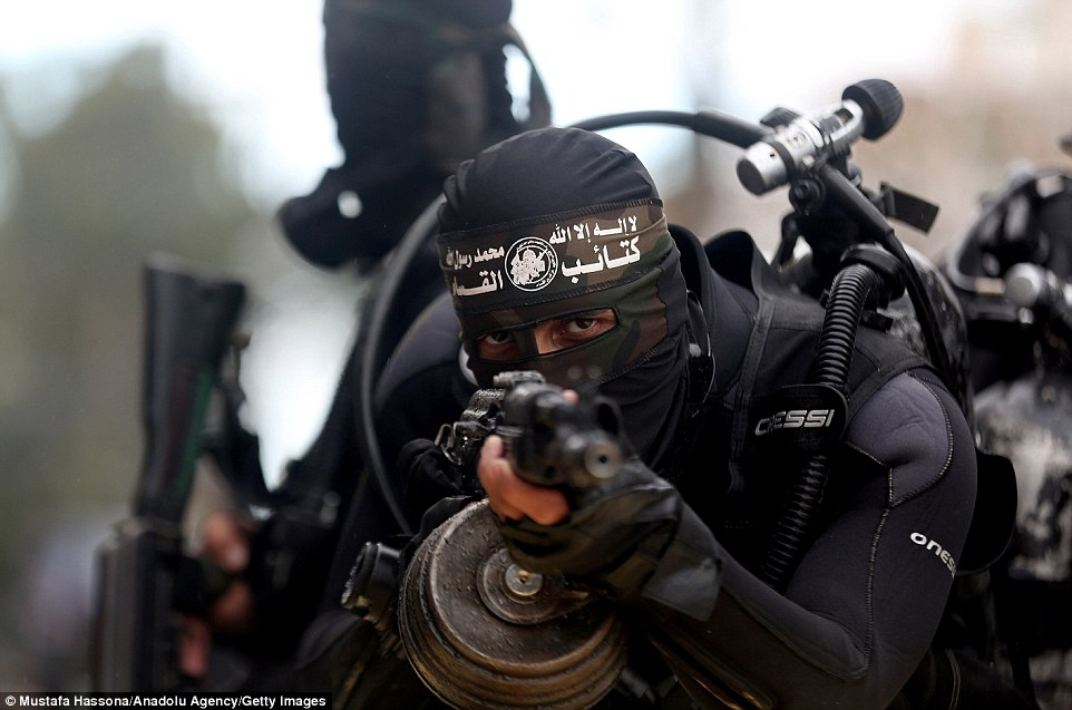 Hamas seized control of the Gaza Strip in 2007 from Fatah forces loyal to Palestinian President Mahmoud Abbas. Pictured, a fighter points his rifle at the camera