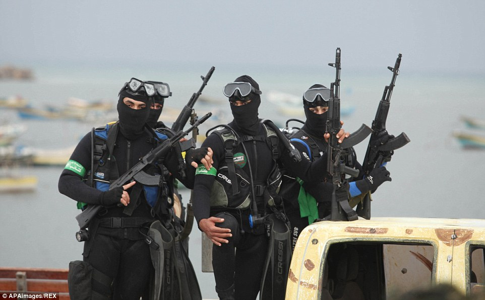 Palestinian members of the marine unit of al-Qassam Brigades, dressed in their military uniform, pose during the celebrations